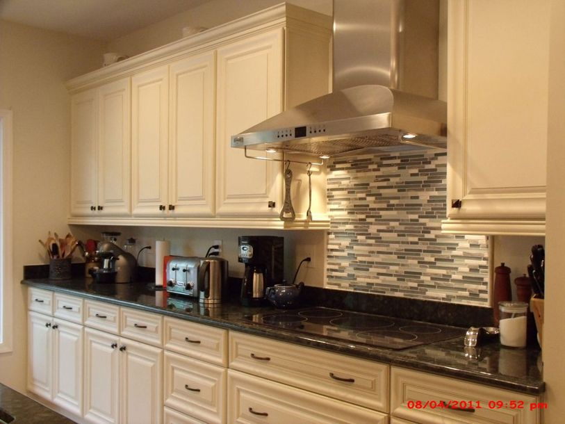 galley kitchen cream cabinets afreakatheart