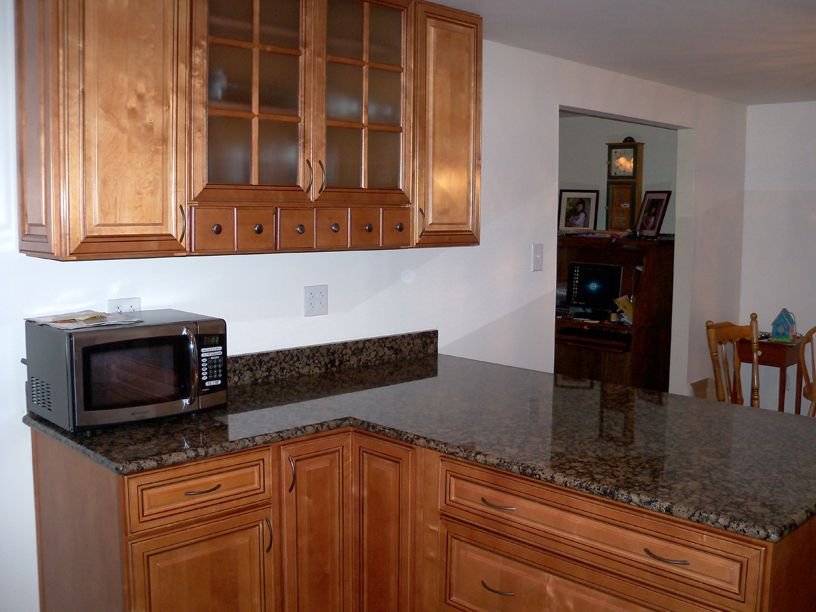 /files/2766246/uploaded/Copyright Kitchen Cabinet Discounts RTA Kitchen Cabinet Discounts Makeover Kristin spice drawers.jpg